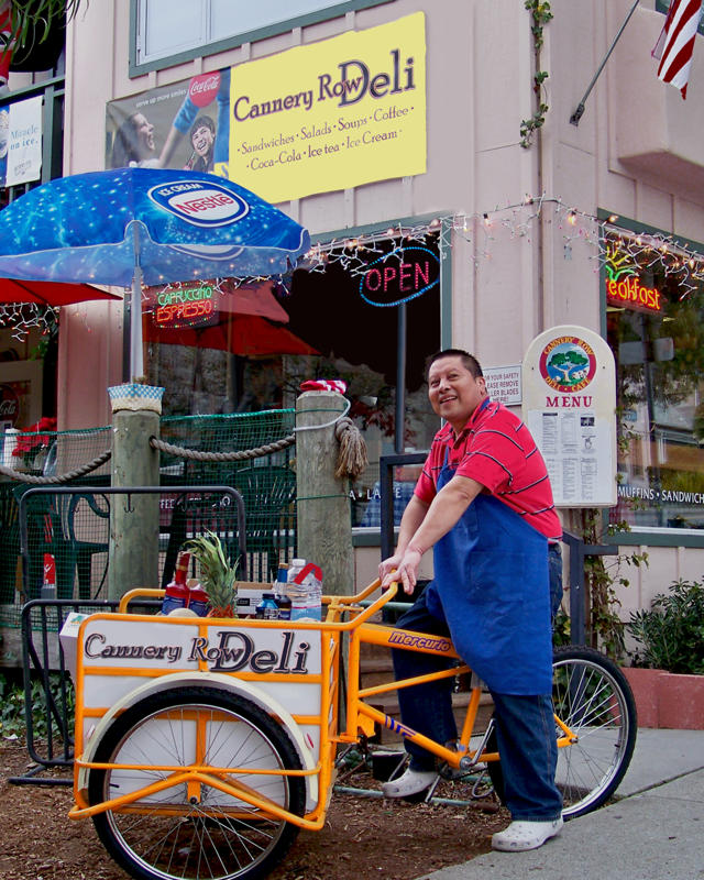 Isidro, just back from a supply run, in front of his Cannery Row Deli. (Photo courtesy of David Lang.)