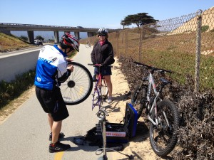This woman with a flat and no needed innertube wasn't part of the Bike Week Intergenerational Ride, but that didn't stop Good Samaritan Robert Cepeda of SportsCenterBicycles.net of Seaside from stopping to help her--free of charge!